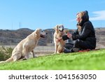 woman and dogs playing in the... | Shutterstock . vector #1041563050