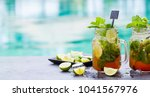 mojito cocktail in glass jars... | Shutterstock . vector #1041567976