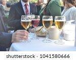 business men drinking beer in a ... | Shutterstock . vector #1041580666
