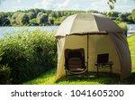 fishing umbrella at river or... | Shutterstock . vector #1041605200