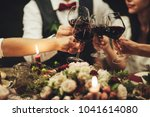 group of people celebrating... | Shutterstock . vector #1041614080