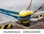 a mooring bollard entwined with ... | Shutterstock . vector #1041616033
