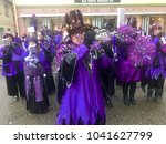 Small photo of Weil der Stadt, Germany - February 11, 2018: Traditional carnival in South Germany - Swabian-Alemannic Fastnacht. A local group in fancy costumes is performing traditional Guggenmusik, brass and