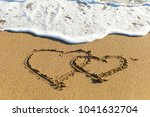 sea waves in the sand with love ... | Shutterstock . vector #1041632704
