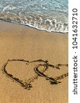 sea waves in the sand with love ... | Shutterstock . vector #1041632710