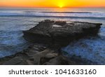 flat rock formation and distant ... | Shutterstock . vector #1041633160