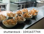 dishes with breadcrumbs in the... | Shutterstock . vector #1041637744