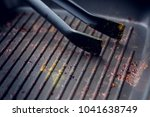 dirty grill pan after baking... | Shutterstock . vector #1041638749