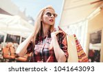 woman in shopping. woman with... | Shutterstock . vector #1041643093