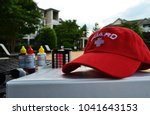 Lifeguard hat lying on a pool book near the chemical control liquids close up photo - stock photo