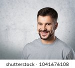 young handsome male on gray... | Shutterstock . vector #1041676108