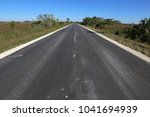 the main park road running... | Shutterstock . vector #1041694939