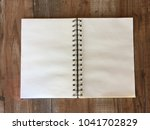 top view blank notebook on... | Shutterstock . vector #1041702829