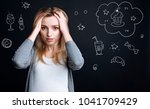 diet. hungry young woman... | Shutterstock . vector #1041709429