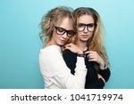 two pretty girls in glasses are ... | Shutterstock . vector #1041719974