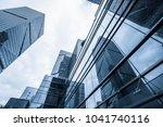 modern office building against... | Shutterstock . vector #1041740116