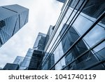 modern office building against... | Shutterstock . vector #1041740119