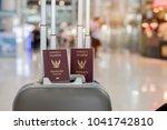 2 books of thai passport put on ... | Shutterstock . vector #1041742810