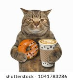 Stock photo the cat holds a cup of coffee and orange glazed donut white background 1041783286
