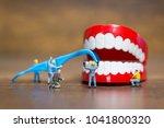 miniature people   worker team... | Shutterstock . vector #1041800320