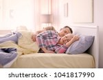 senior couple in bed together... | Shutterstock . vector #1041817990