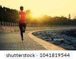 sporty fitness woman running on ... | Shutterstock . vector #1041819544