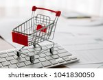 shopping cart on a laptop... | Shutterstock . vector #1041830050