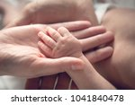 small hand of newborn baby in... | Shutterstock . vector #1041840478