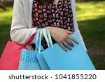 woman with shopping bags  close ... | Shutterstock . vector #1041855220