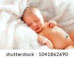 newborn baby sleeping on white...   Shutterstock . vector #1041862690