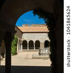 Small photo of Cloister of the abbey of Sant Pere de Rodes. It is a former Benedictine monastery in the comarca of Alt Emporda, in the North East of Catalonia, Spain.