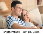 young couple on sofa at home | Shutterstock . vector #1041872806