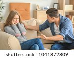 young couple in quarrel at home | Shutterstock . vector #1041872809