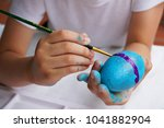 Kid Painting Color On Egg...