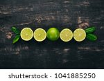 fresh green lime. fruits. on a... | Shutterstock . vector #1041885250