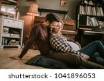 pregnant woman with a husband... | Shutterstock . vector #1041896053