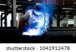 welding with sparks by process... | Shutterstock . vector #1041912478