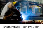welding with sparks by process... | Shutterstock . vector #1041912484