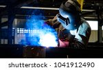 welding with sparks by process... | Shutterstock . vector #1041912490