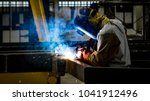 Small photo of Welding with sparks by Process fluxed cored arc welding ,Industrial steel welder part in factory.