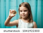 little girl examining a bitcoin ... | Shutterstock . vector #1041922303