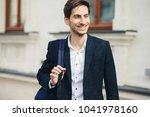 portrait of smiling handsome... | Shutterstock . vector #1041978160