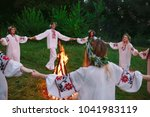 midsummer. young people in... | Shutterstock . vector #1041983119