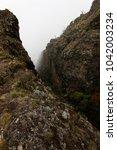 valleys and peaks on mount... | Shutterstock . vector #1042003234