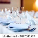 beautifully served table in a... | Shutterstock . vector #1042005589