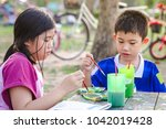 portrait of little girl and boy ... | Shutterstock . vector #1042019428