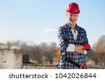smiling craftsman with arms... | Shutterstock . vector #1042026844