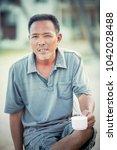 face of asian man relaxing...   Shutterstock . vector #1042028488