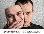 a man wearing a hilarious mask... | Shutterstock . vector #1042033690