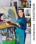 girl in painting studio   Shutterstock . vector #1042070638